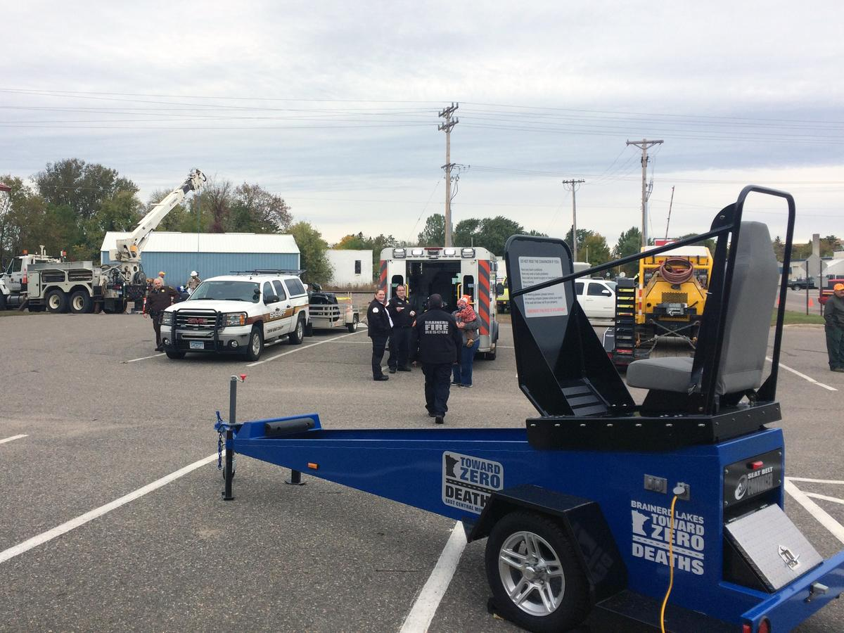 East Central MN seat belt convincer set up in parking lot for event