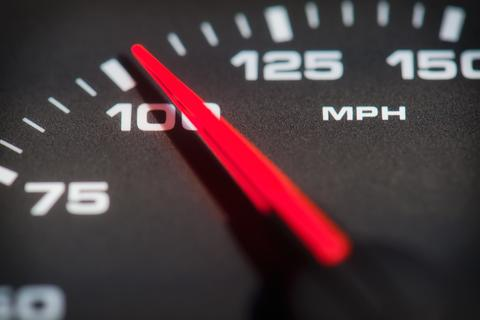 Vehicle speedometer showing 100 mph