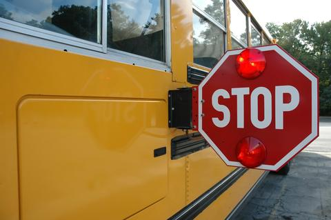 School bus with stop sign engaged