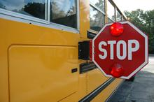 school bus with stop arm extended